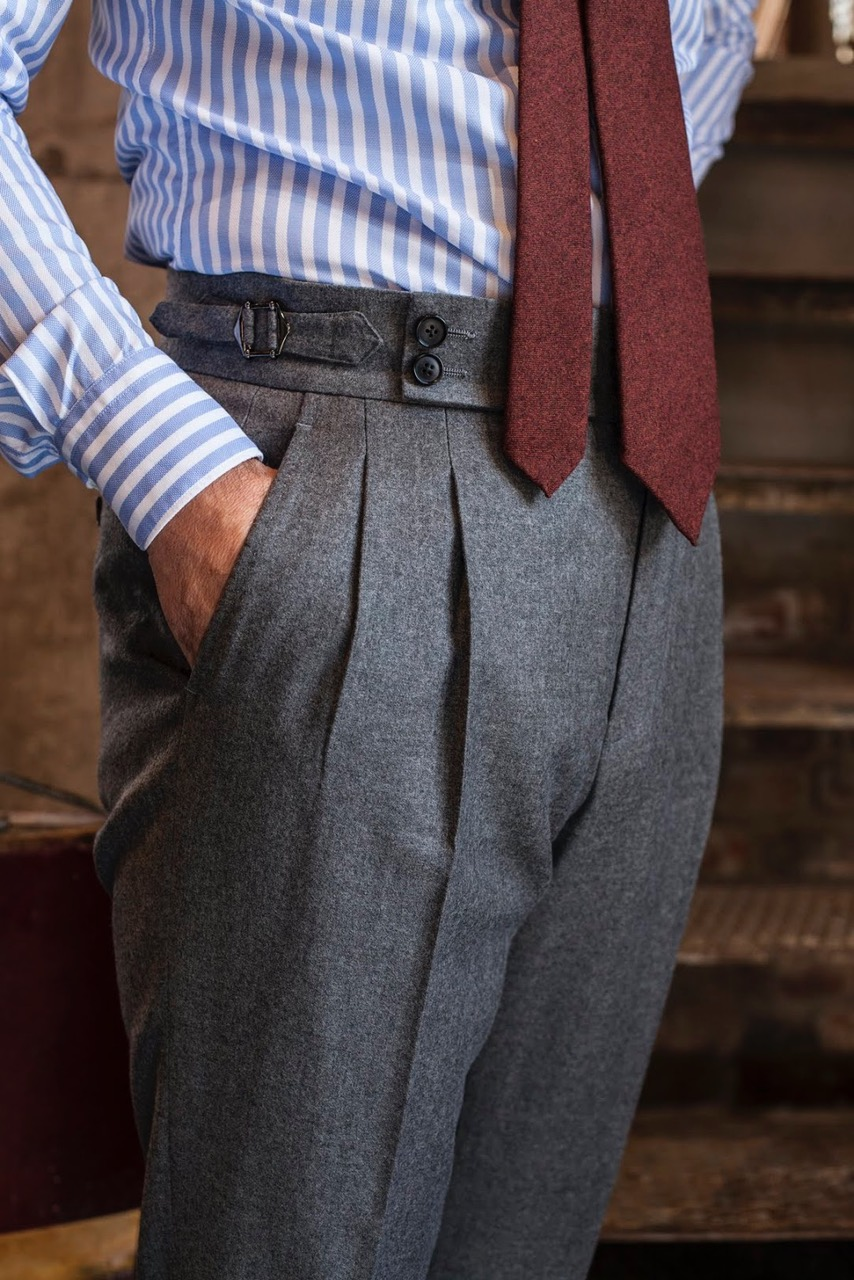 grey flannel trousers with side adjusters